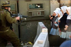 Settlers and soldiers make life extremely difficult for Palestinians in Hebron. At least one school has been forced to close because students were harassed so badly by Israeli settlers