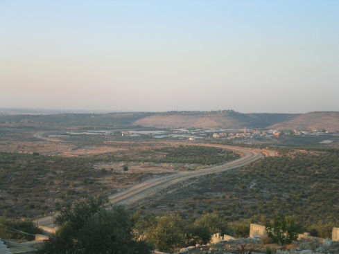 The village in the valley (to the left) is Falamya, a neighbor of Jayyous. On the hilltop above Falamya is an illegal Israeli settlement -- one of many in the area.
