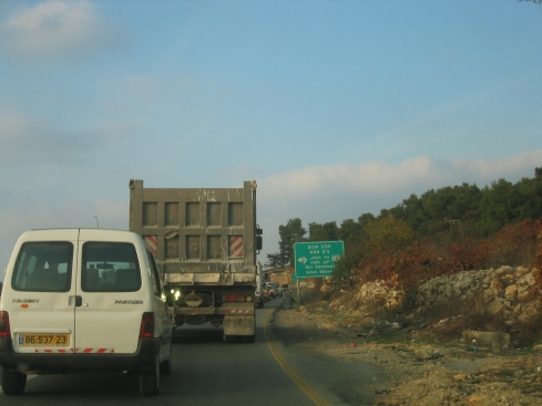 "Traffic snarls are common in the West Bank due to both established and ""flying"" checkpoints. Notice that although this picture was taken in the West Bank, the sign is in Hebrew first, and it points to an Israeli town called Beit Shemesh and a settlement called Alon Shvut. Nearby Palestinian cities and towns aren't mentioned. This is common on West Bank roads."